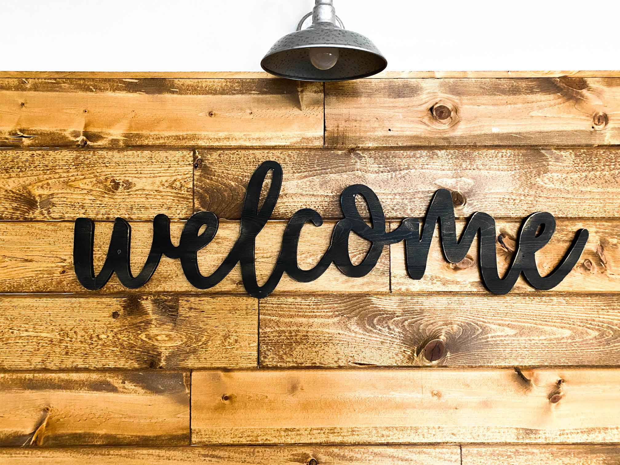 Welcome sign on wood with black script writing and a light overhead. Visit New Hope Christian Church for Counseling and Therapy at ThrivePointe in Whitestown, IN 46075