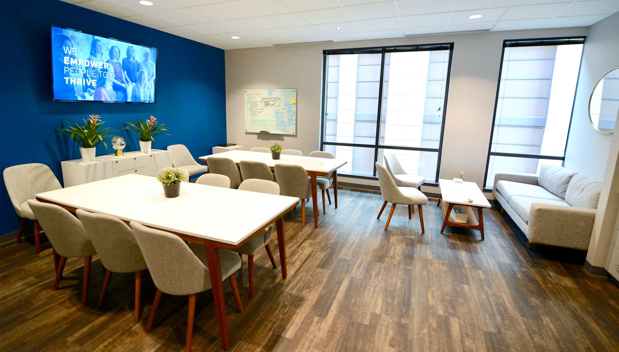 Brightly lit room with windows and modern rustic wooden feel for group counseling and therapy workshops at Liberty Center. ThrivePointe Counseling in Liberty Township, OH 45069